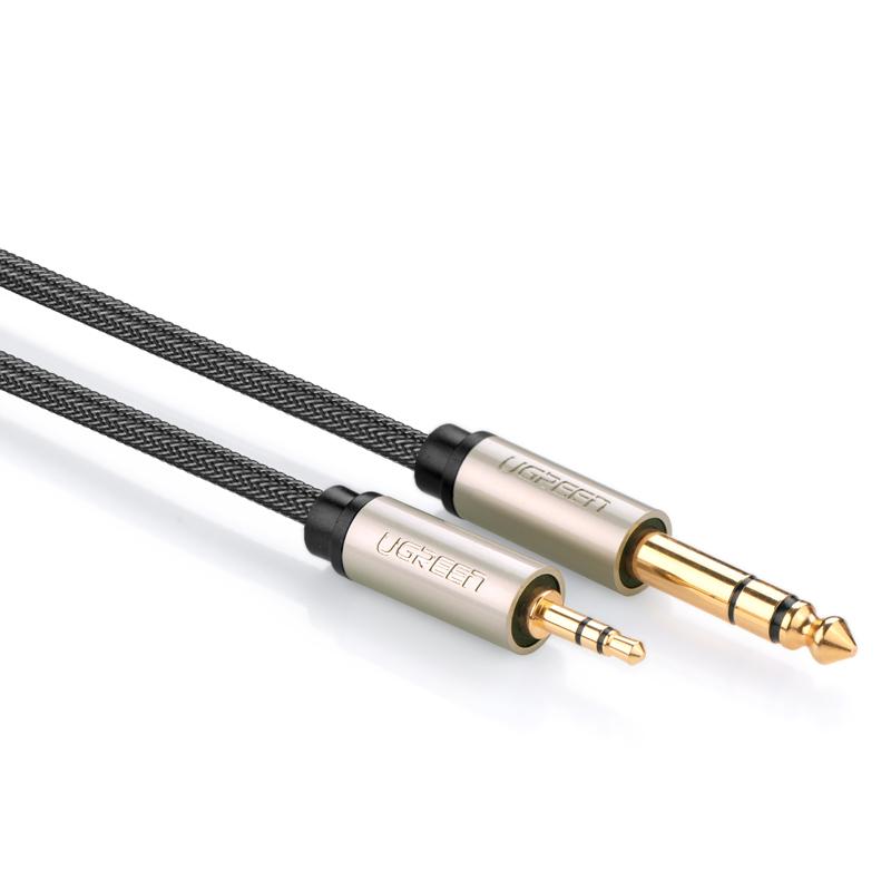 10米 10632 绿联3.5转6.5音频线采用全铜线芯,高密度铜编织网+铝箔屏蔽层,接头15μ镀金,音质更纯净,确保信号高保真无损传输。音频线外被水晶编织网给线材带来最好的保护,防刮,防压,防磨,防滑一步到位,有效延长使用寿命。适用于3.5与6.5接口的音频设备相连接,如手机、音响、麦克风、功放、调音台等。